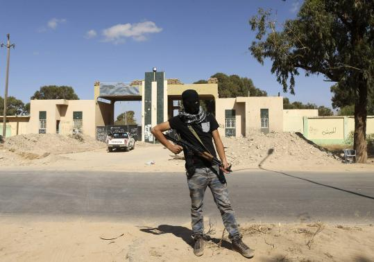 militia-stands-guard-front-entrance-february-17-militia-camp-after-libyan-irregular-forces
