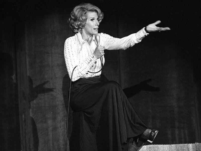 In this August. 13, 1975 photo, comedian Joan Rivers performs at the MGM in Las Vegas. The raucous, acid-tongued comedian who crashed the male-dominated realm of late-night talk shows