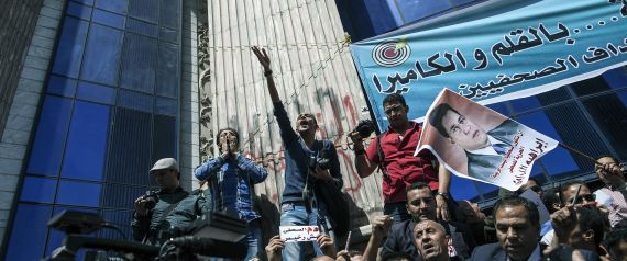 Journalists and photojournalists shout slogans as they demonstrate against repeated attacks on members of the press on April 17, 2014 in front of the building of the Press Syndicate in Cairo. The union asked the journalists working in Egypt to go on strike to ask for guarantee of safety and security while doing their jobs as they have faced an increasing amount of violence in recent years while covering protests and clashes. AFP PHOTO / MAHMOUD KHALED (Photo credit should read MAHMOUD   MAHMOUD KHALED via Getty Images