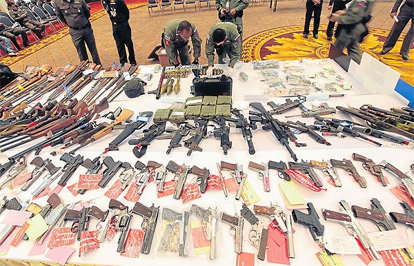 A weapons catch seized by the Thai army from Shinawatra's armed networks in the wake of the 2014 coup.