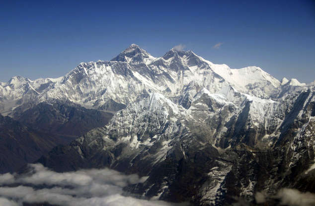 FILE (Mail Online) - This Oct. 21, 2005 file photo shows Mount Everest from an aerial view taken over Nepal. Senior mountaineering guide, Ang Tshering, said an avalanche swept the face of Mt. Everest after the massive earthquake, Saturday April 25, 2015 while government officials say at least 30 people have been injured on the mountain. (AP Photo/Jody Kurash, File)