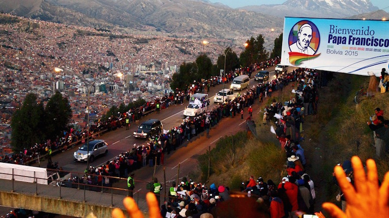 Pope Francis rides on a popemobile on a road leading from El Alto to La Paz, on the outskirts of La Paz, Bolivia.