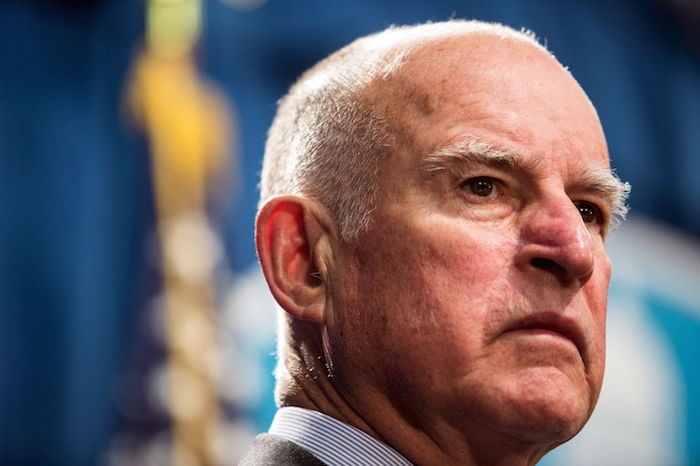 California Governor Jerry Brown looks on during a news conference at the State Capitol in Sacramento, California March 19, 2015, to announce a $1 billion emergency legislative package to deal with the state's devastating, multiyear drought. The state is entering a fourth year of record-breaking drought that has prompted officials to sharply reduce water supplies to farmers and impose strict conservation measures statewide. REUTERS/Max Whittaker - RTR4U33I