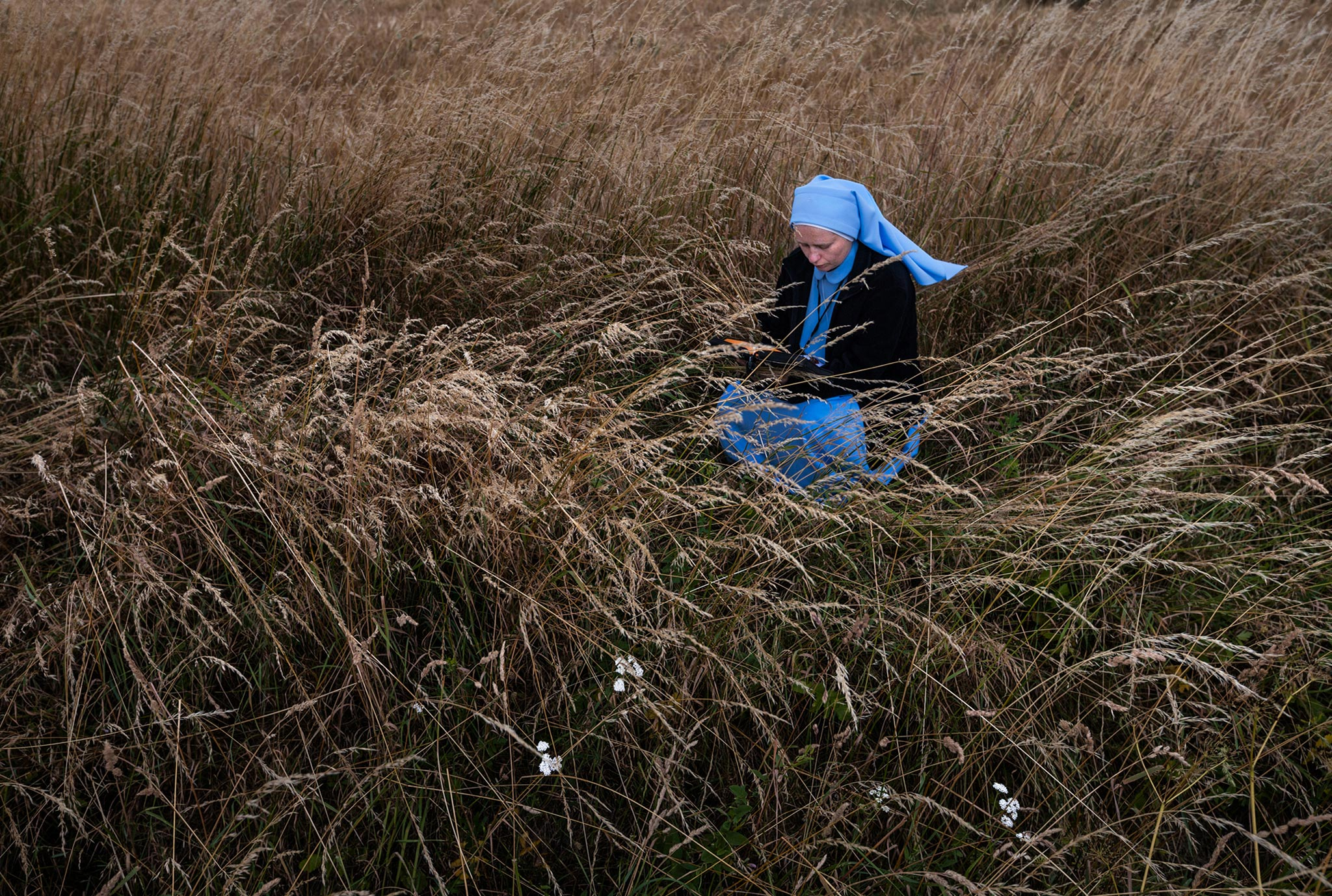 Sister Marzena Michalczyck, 31, a nun from Kraków, Poland, pauses to pray during her weeklong walk to Częstochowa. Millions of pilgrims trek there to see the Black Madonna, an icon believed to bestow miracles upon the faithful.