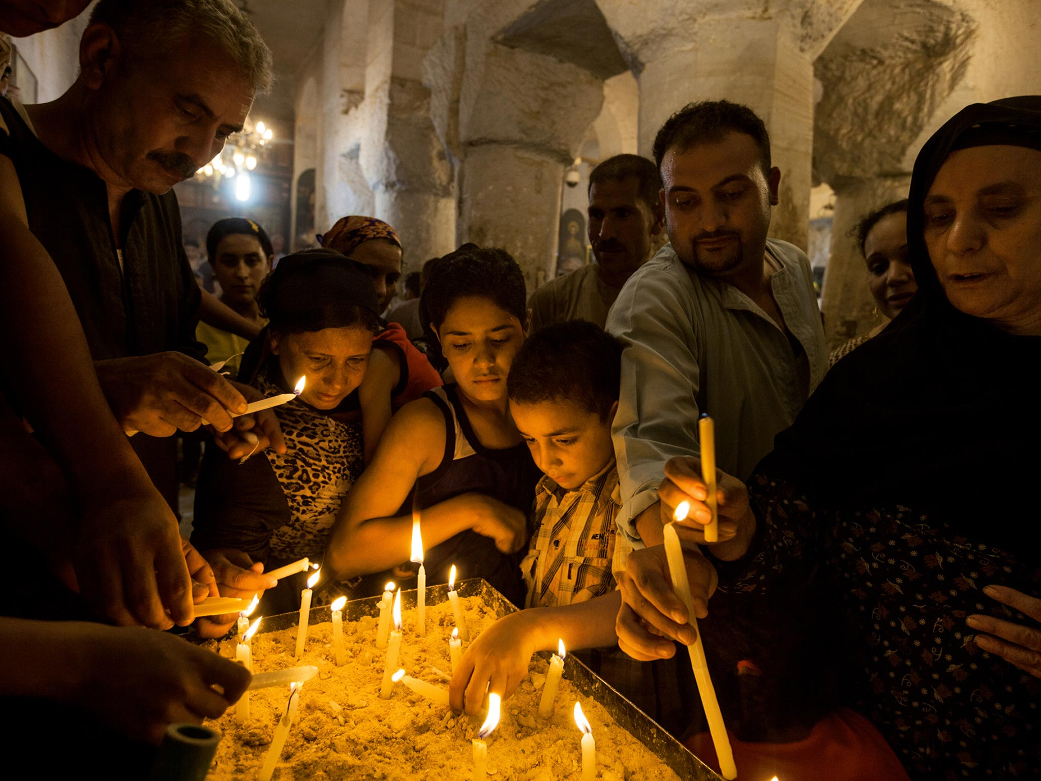 In the Deir al Adra monastery, in Minya, Egypt, Muslims and Christians alike light candles to commemorate the Holy Family's stay during their biblical flight into Egypt. A Marian festival here draws two million of the faithful each year.