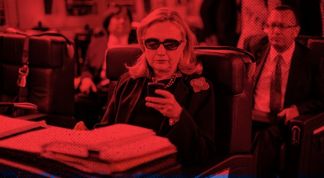 Secretary of State Hillary Clinton checks her phone on board a plane from Malta to Tripoli, Libya. (Kevin Lamarque / Reuters / Zak Bickel / The Atlantic)